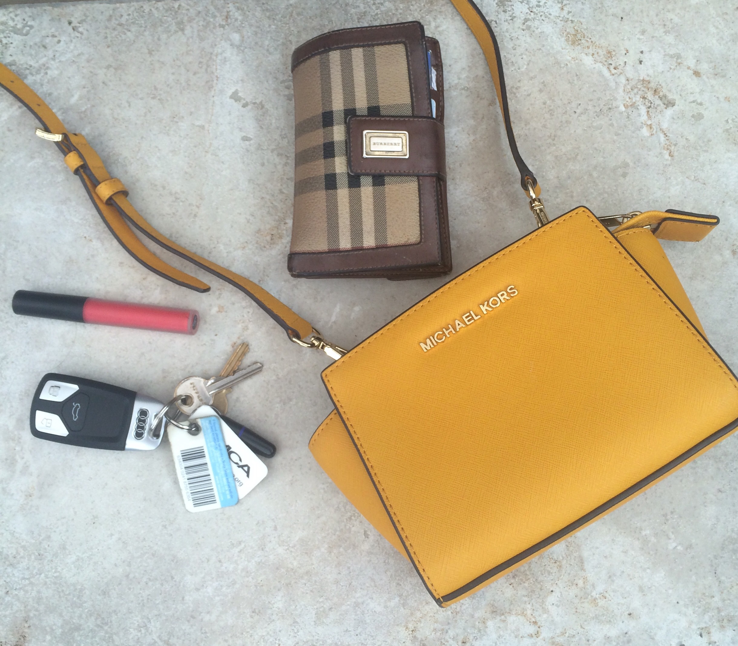 small Michael Kors handbag with only keys , phone and lipstick