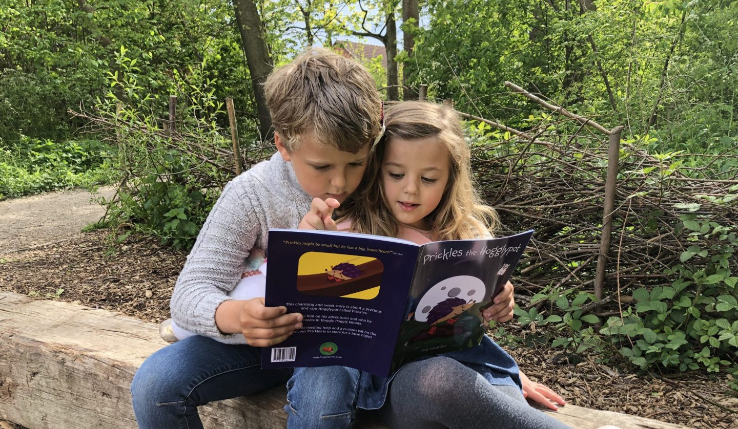Kids reading Prickles the Hogglypot in woods